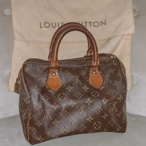 LV speedy25 brown monogram canvas satchel I think